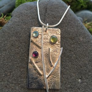 branching out pendant with multiple gemstones