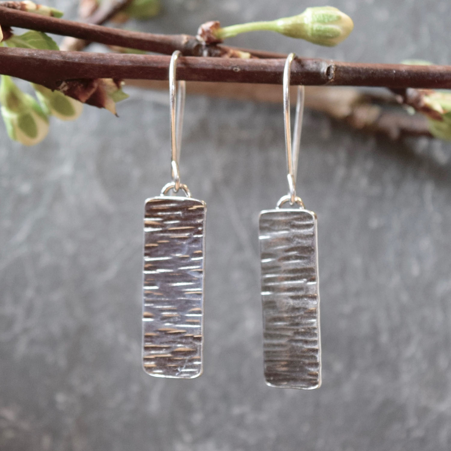 Saucy Jewelry dangling textured silver earrings