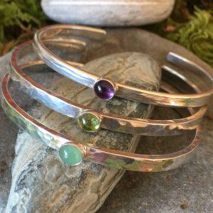 three baleen hammered bracelets with gemstones