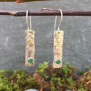 silver, gold, and emerald earrings