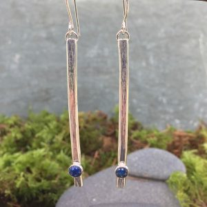 long silver earrings with gemstones