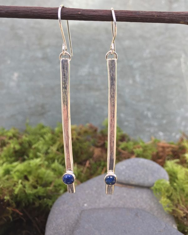 long silver earrings with gemstones
