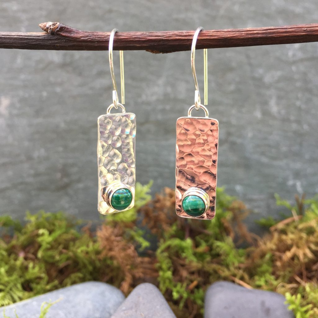 textured silver earrings with emeralds
