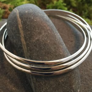 Saucy Jewelry rolling interconnected bracelets