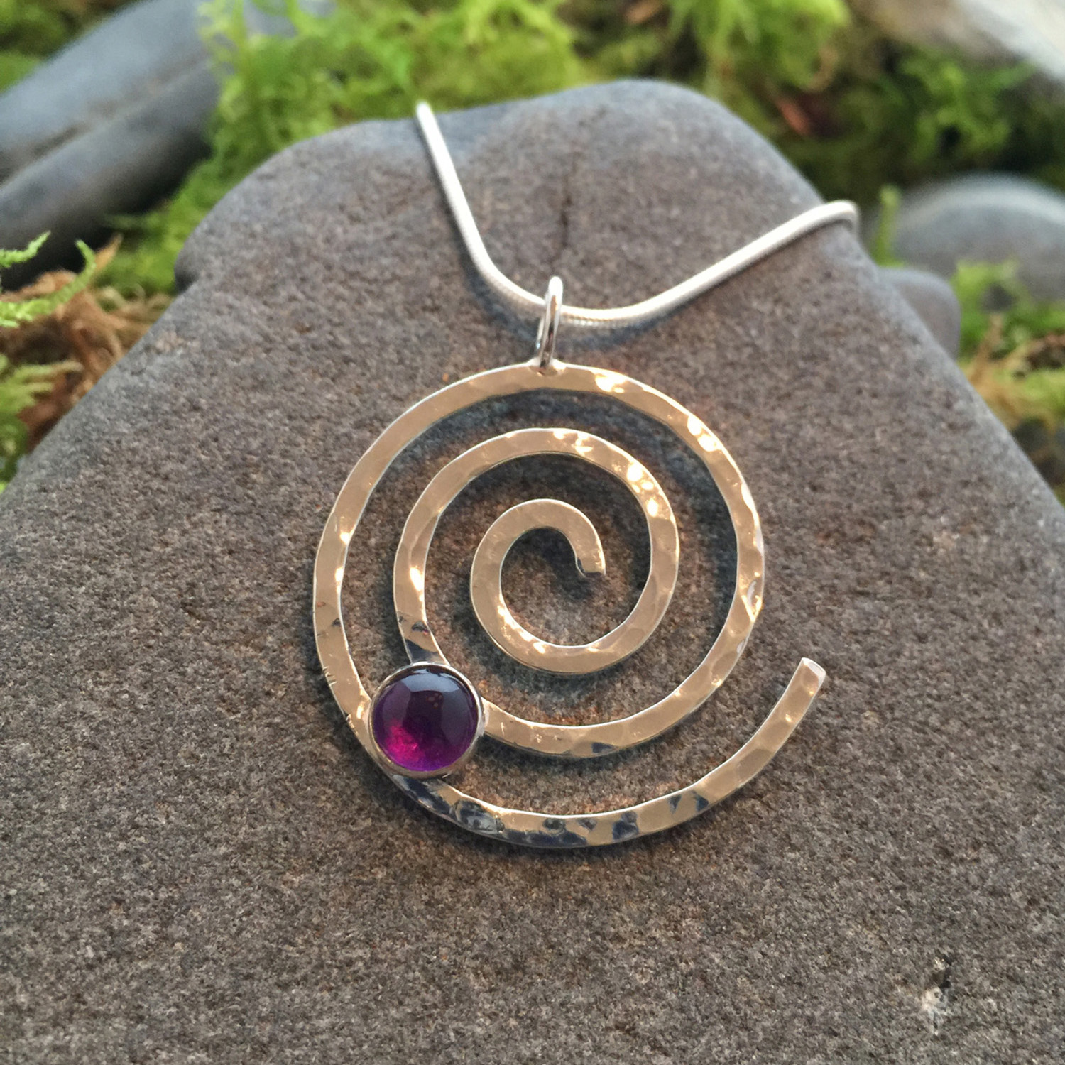 Saucy Jewelry spiral pendant with red gem